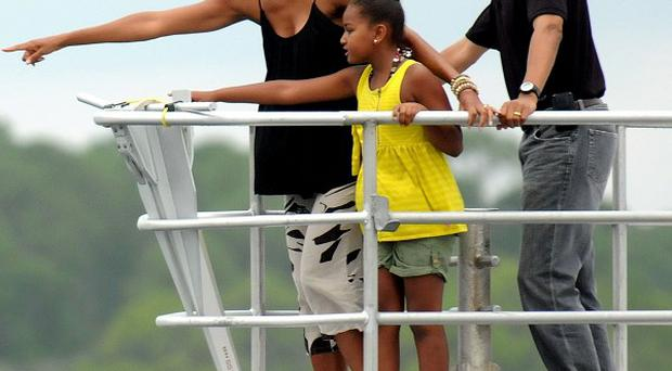 President Barack Obama, first lady Michelle and daughter Sasha in Florida