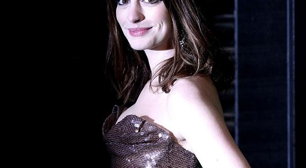 Anne Hathaway is apparently in talks to star in Lola Versus