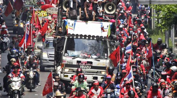 Thailand's prime minister has partially lifted a state of emergency after protests in three provinces