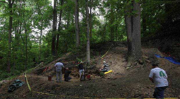 Researchers work at the site believed to be a mass grave for Irish immigrants