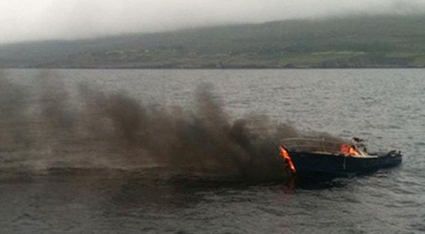 A boat on fire in Bantry Bay, near Adrigole harbour, in which three people were killed