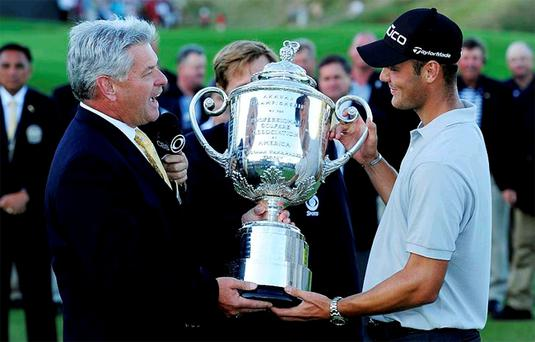 PGA of America president Jim Remy presents the Wanamaker Trophy to Martin Kaymer