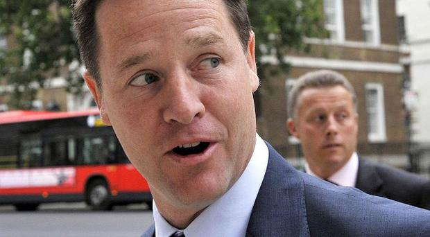 Deputy Prime Minister Nick Clegg arrives at the Cabinet Office in London