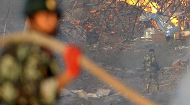 Soldiers tackle a blaze at a fireworks factory in Yichun, a city in north-east China's Heilongjiang Province