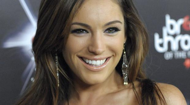 Kelly Brook has shed her clothes for a Playboy shoot and a movie