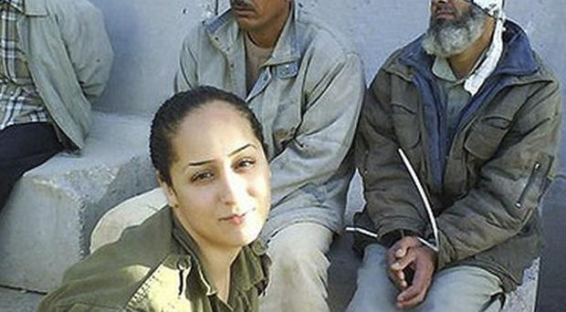 Eden Aberjil posted photos on Facebook of herself smiling beside Palestinian prisoners (AP)