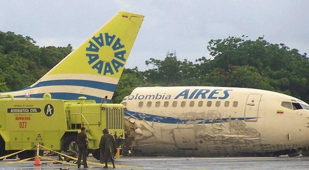 A plane that crashed lies in pieces along the runaway at the airport on San Andres island in Colombia (AP)