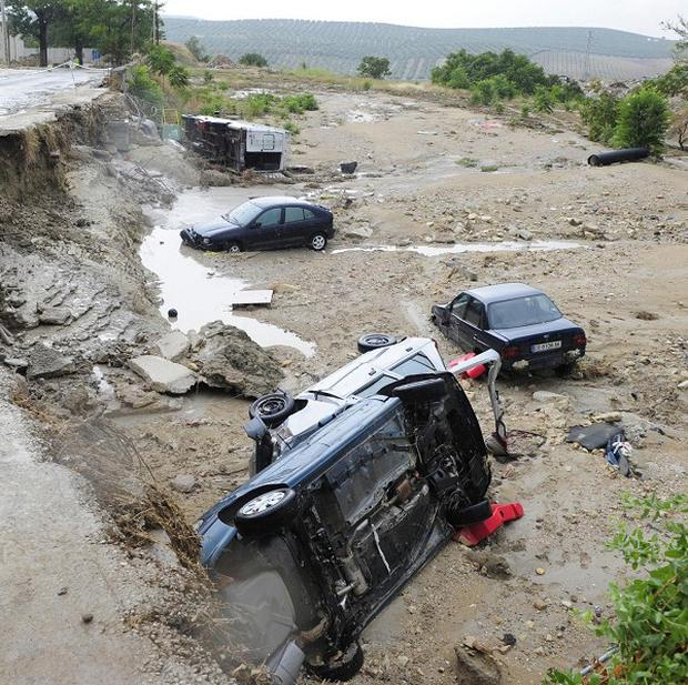 Cars washed away amid flooding in Aguilar de la Frontera, southern Spain