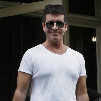 Simon Cowell says X Factor judges sometimes overshadow the singers