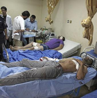 Victims of a suicide attack are tended at a hospital in Baghdad, Iraq