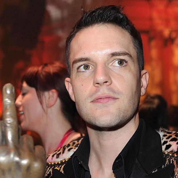 Brandon Flowers says performing solo is like cheating on his wife
