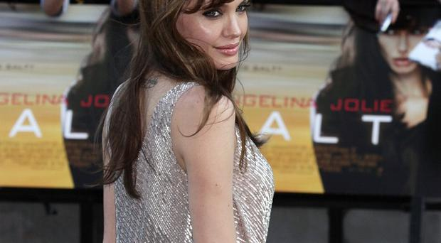 Angelina Jolie would happily make a sequel to Salt