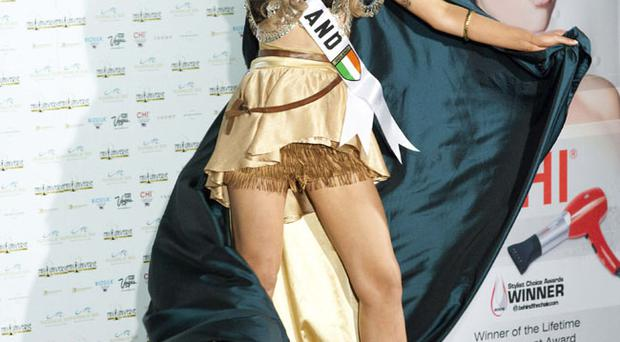 Miss Ireland Rozanna Purcell poses in her national costume