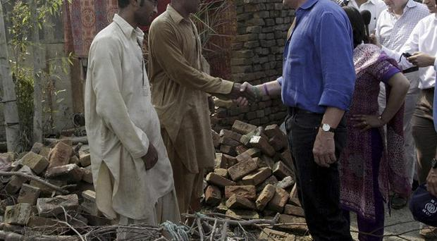 Andrew Mitchell meets flood victims in Nowshera, Pakistan