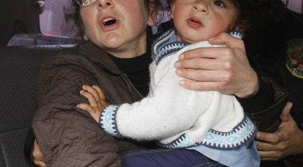 Lori Berenson, carrying her 15-month-old son, Salvador, arrives at the Justice Palace in Lima