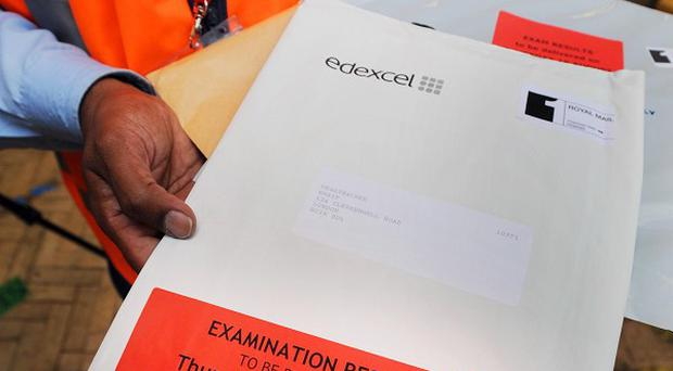Packages containing A-level exam results for the London area are sorted for delivery by the Royal Mail