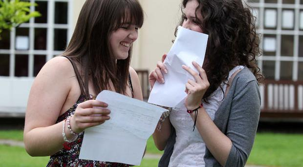 Students from Victoria College, Belfast Cathryn Anderson(right) who achieved 4 A* in Biology, Chemistry, Mathematics and Physics A levels is congratulated by her firend Rachel McLaughlin who got an A in biology, history and geography.