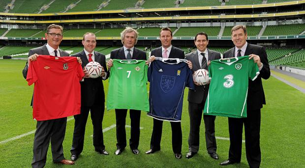 CARLING ALL THE HEROES: Niall McMullan (second from left), head of sales for Molson Coors in Northern Ireland, and Niall Phelan, Molson Coors country manager for Ireland, were joined by former international legends (l-r) Ian Walsh of Wales, Pat Jennings of Northern Ireland, Craig Burley of Scotland, and Packie Bonner, Republic of Ireland, at the launch of beer brand Carlings sponsorship of the inaugural Carling Nations Cup, a new international football tournament which will see Northern Ireland take on the Republic of Ireland, Scotland and Wales at the new state of the art Aviva Stadium in Dublin early next year. The Carling Nations Cup, which kicks off on Tuesday February 8 2011, will be the first senior international tournament hosted in Ireland and marks a significant investment by Carling. Carling has been a major sponsor of football for many years, and todays announcement builds upon its range of other sponsorships which include the Carling Premiership in Northern Ireland, the Carling Cup in England and Wales and most recently its sponsorship of the Scottish National Team and Scottish Cup. Picture credit: Ray McManus / SPORTSFILE *** NO REPRODUCTION FEE ***