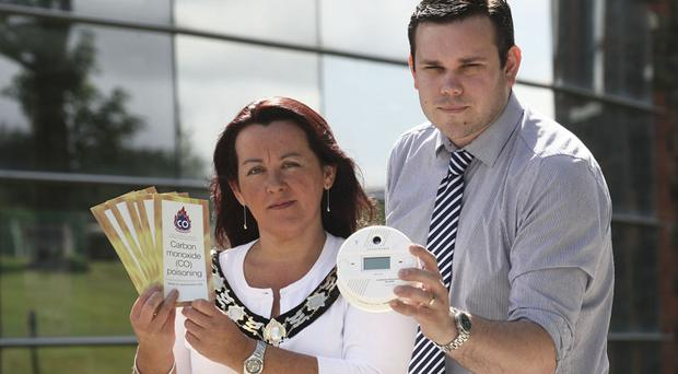 Newtownabbey Borough Council home accident prevention officer, Tom Durrant, joins Mayor Paula Bradley, to raise awareness of the dangers of carbon monoxide