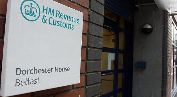 HM Revenue and Customs have sacked seven workers in Belfast amid claims of racial abuse