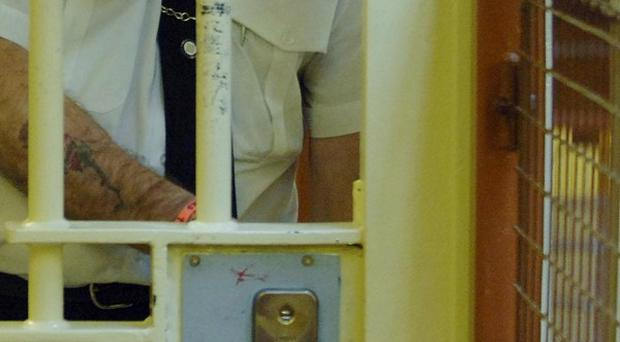 A female prisoner has died after being found in her cell unconscious
