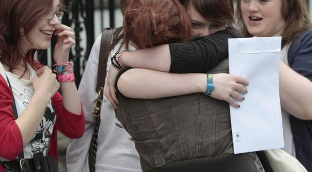 Students celebrate after receiving their leaving certificate exam results outside Loreto College, Dublin