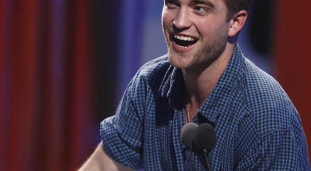 Robert Pattinson has topped a poll of the sexiest celebrity men