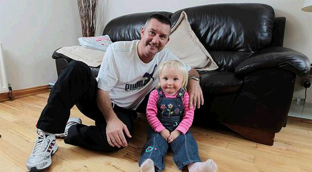 Cliftonville boss Eddie Patterson, relaxing at home with his 18-month old grand-daughter Cady, needed the support of his family after receiving a death threat
