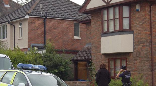 The police cordon outside the home of Chris Hall where he was found dead with his young son, also called Chris, in Poole