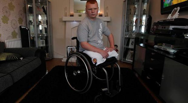 Wounded hero: Andy Allen, injured in a bomb blast in Afghanistan, at home in Belfast