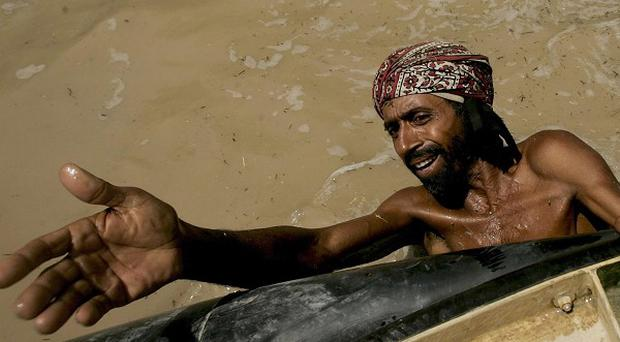 A Pakistani flood survivor waits to get relief in southern Pakistan. Peter Powell TD has told the UN more needs to be done to aid victims (AP)