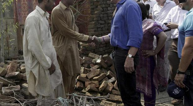 International Development Secretary Andrew Mitchell meets flood victims in Nowshera, Pakistan