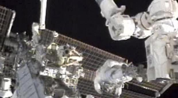 Astronauts can become as weak as 80-year-olds after six months at the Space Station (AP)