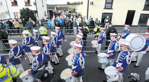 People protest against the loyalist band parade in Rasharkin, Co Antrim last night