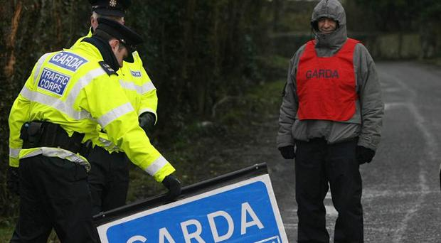 Garda traffic cops are examining a stretch of road in Co Kildare where two men were killed in a car crash on Thursday