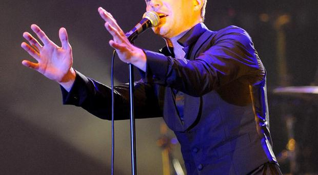 Brandon Flowers said making a solo album helped him with his grief