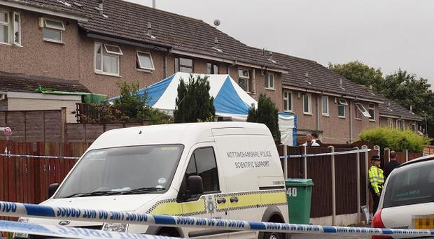 Police search Heatherington Gardens in Nottingham where a man was found shot dead.