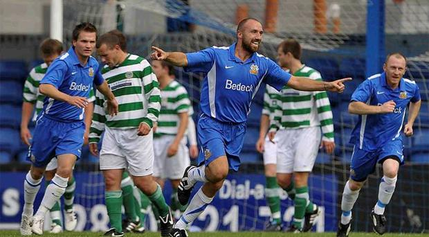 Tony Grant wheels away in delight after scoring his second goal against Donegal Celtic