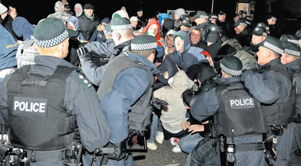 Police officers clash with nationalist protesters in Rasharkin on Friday night