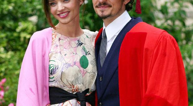 Orlando Bloom, pictured with wife Miranda Kerr, said he was excited at becoming a father