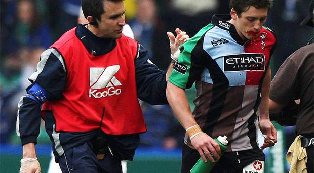 Tom Williams of Harlequins with blood pouring from his mouth in a Heineken Cup game