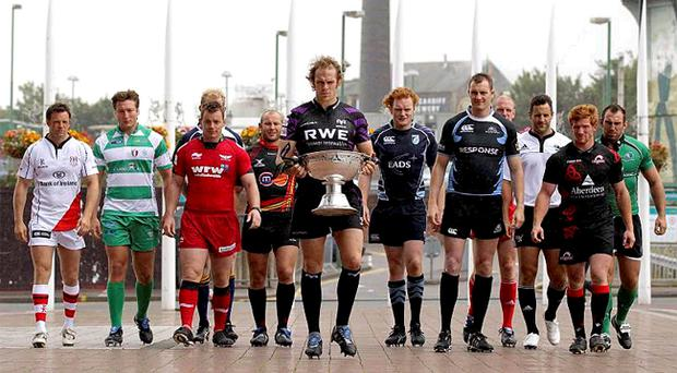 Captains and leading players from the 12 Magners League sides, including Ulster's Bryn Cunningham (second left) at Cardiff's Millennium Stadium for yesterday's launch