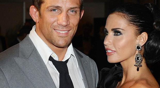 Katie Price insisted that she and Alex Reid still love each other amid rumours their marriage is on the rocks