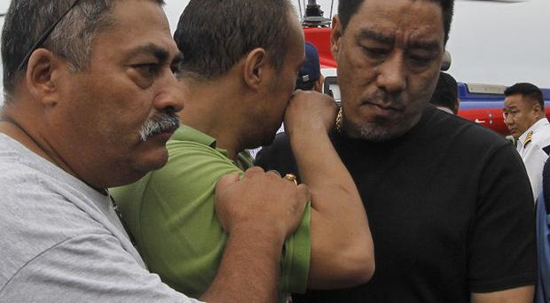 People comfort each other as bodies of relatives, victims of a plane crash, are brought in to Katmandu, Nepal (AP)