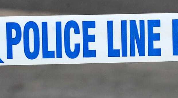 Two people have been arrested after the sudden death of a man in Lisburn