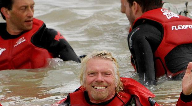 Sir Richard Branson in the sea with fellow kite surfers at Dungeness in Kent