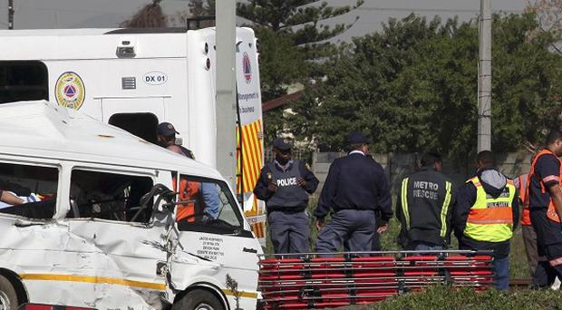 A train hit a van carrying school children on the outskirts of Cape Town, South Africa (AP)