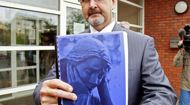 Police Ombudsman Al Hutchinson with a copy of the new report into the 1972 Claudy bombing