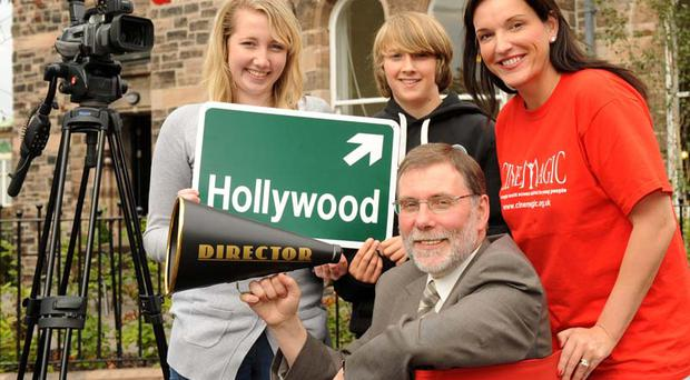 Culture and Arts Minister, Nelson McCausland with Cinemagic students Ashleigh McCracken and Emmet OHagan from south Belfast and Joan Burnet Keatings, Cinemagic chief executive.