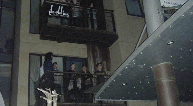 Revellers enjoy Belsonic from one of the many balconies overlooking Custom House Square